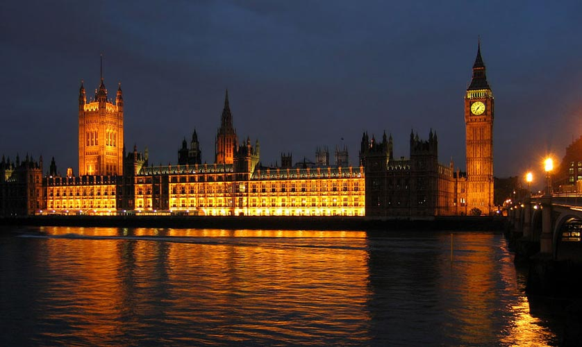 The Palace of Westminster at night seen from the south bank of the River Thames