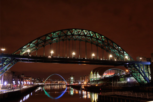 Newcastle by Night with Tyne Bridge at the front and the Gateshead Millennium Bridge in the background