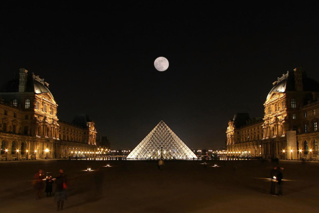 Louvre Pyramid under the moonlight